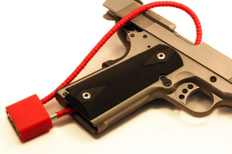FILE - An example of a gun lock on a firearm is shown here.