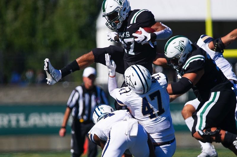 PMG PHOTO: JOHN LARIVIERE - Portland State running back Malik Walker hurdles Montana State defenders on his way to a first down in the first half on Saturday, Sept. 25 at Hillsboro Stadium. Montana State won the Big Sky Conference opener 30-17.