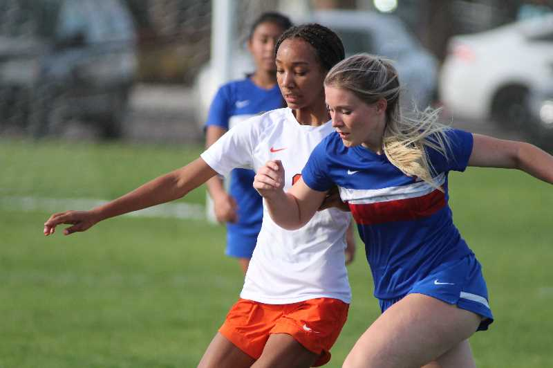 PMG PHOTO: ANDY DIECKHOFF - Madras senior Isabelle Ludi, right, picked up her first goal of the season on Tuesday against Molalla.