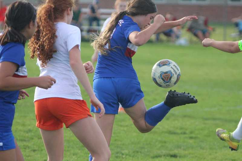 PMG PHOTO: ANDY DIECKHOFF - Emily King, with ball, and the rest of the White Buffalos had a rough start to Tri-Valley play this past week.