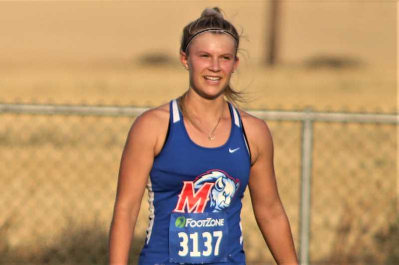 PMG PHOTO: ANDY DIECKHOFF - Madras cross country runner Hannah MacDuffee has finished second place in three consecutive races.