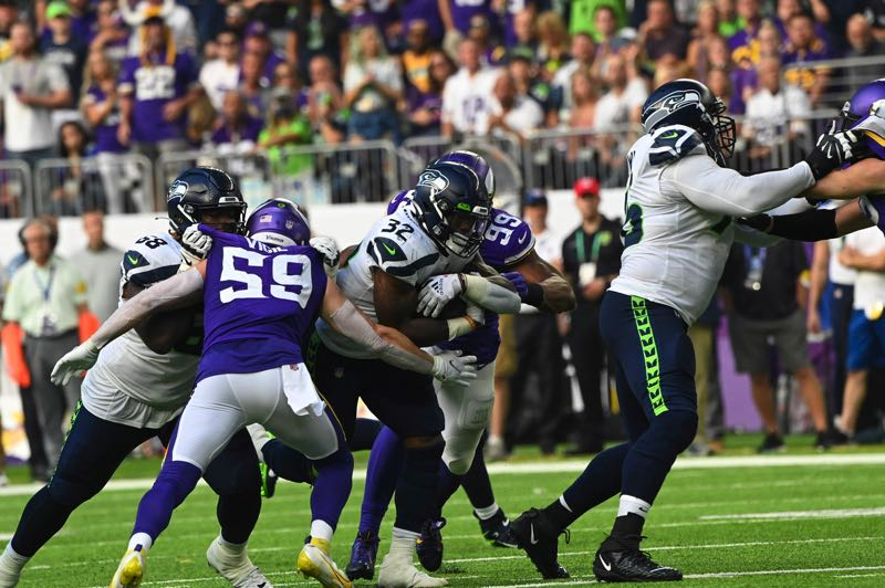 COURTESY PHOTO: MICHAEL WORKMAN - Chris Carson ran for 80 yards, including a 30-yard touchdown, but the Seahawks found consistent yards touch in the second half of a loss at Minnesota.