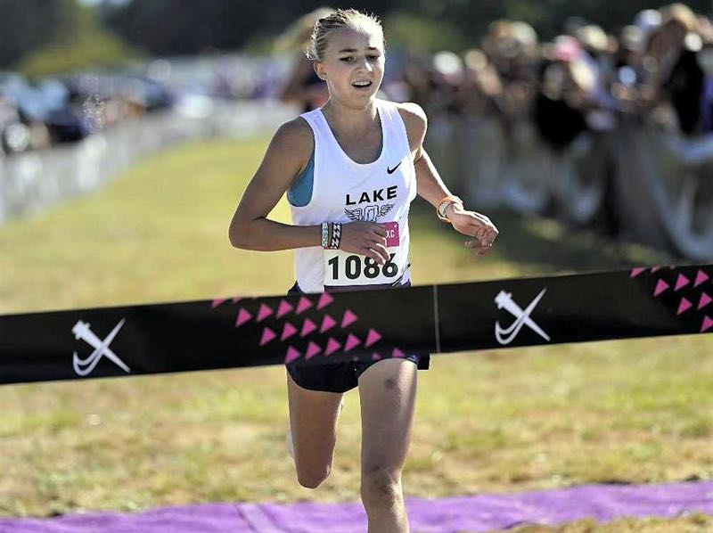 COURTESY PHOTO: JON OLSON - Lake Oswego's Kate Peters crosses the finish line in the Danner Championship race at Blue Lake.