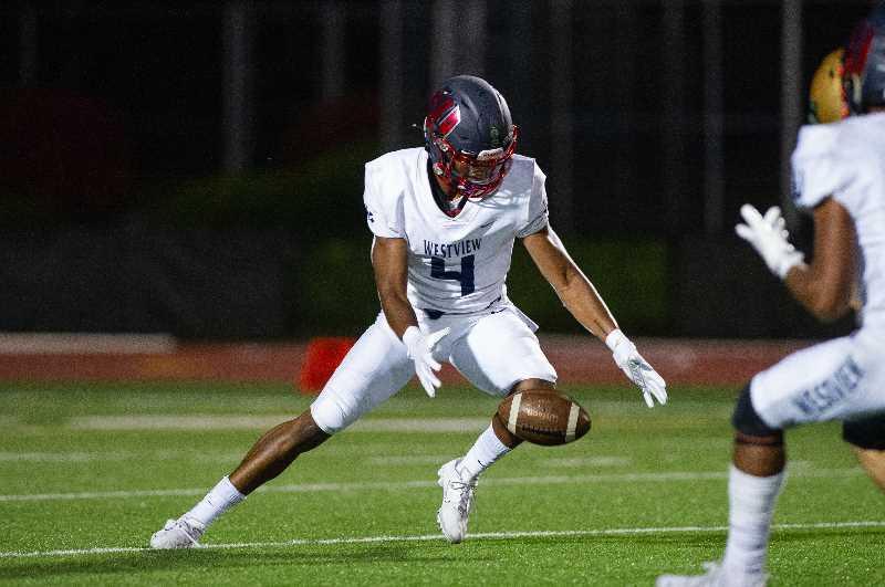PMG PHOTO: JOHN LAVIRIERE - Darius Clemons gathers a loose ball during the Wildcats' game against Jesuit Friday night, Sept. 24, at Jesuit High School. the Westview receiver is one of the country's most sought-after football recruits.