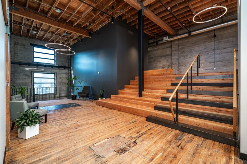 COURTESY PHOTO: TRUEBECK CONSTRUCTION - Open spaces such as this invite impromptu interactions that fuel creativity for office workers.
