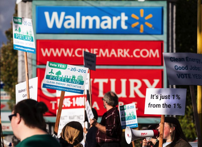 PMG FILE PHOTO: JONATHAN HOUSE - Activists rallied during rush hour in front of the Southeast 82nd Avenue Walmart in support of the creation of a Portland Clean Energy Fund in 2018.