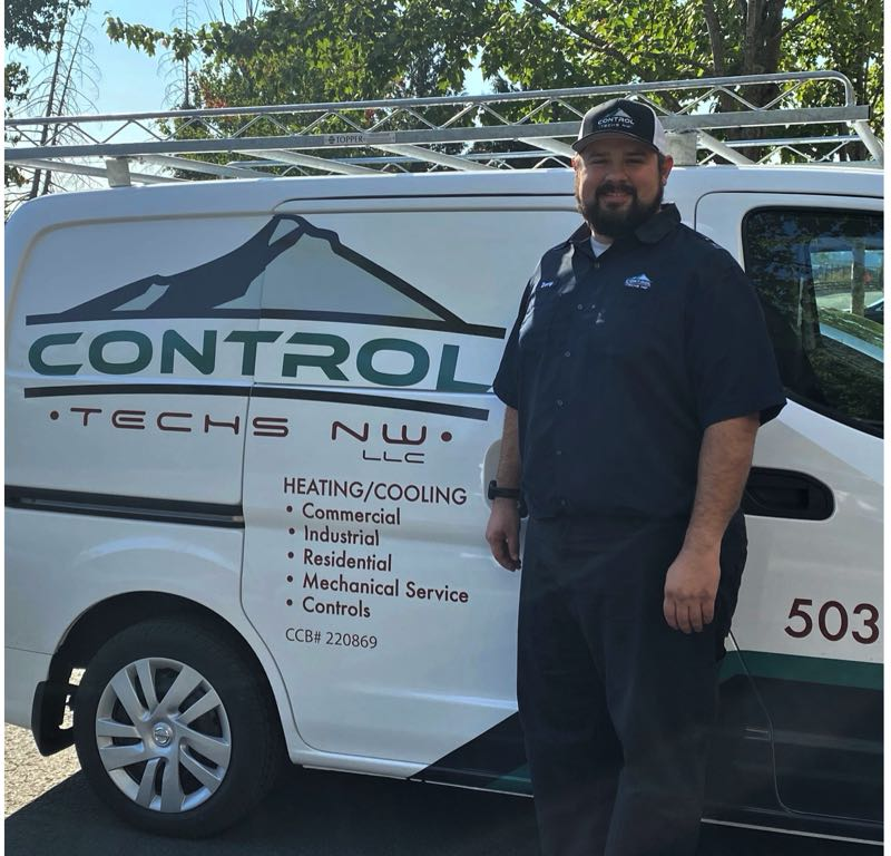 COURTESY PHOTO: CONTROL TECHS NW - Control Techs NW owner Daniel Reyes poses next to a company van.