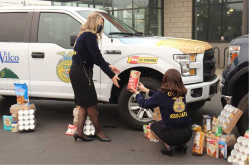 COURTESY PHOTO: OREGON FFA - Oregon FFA members use an assembly line to sort food for the drive.