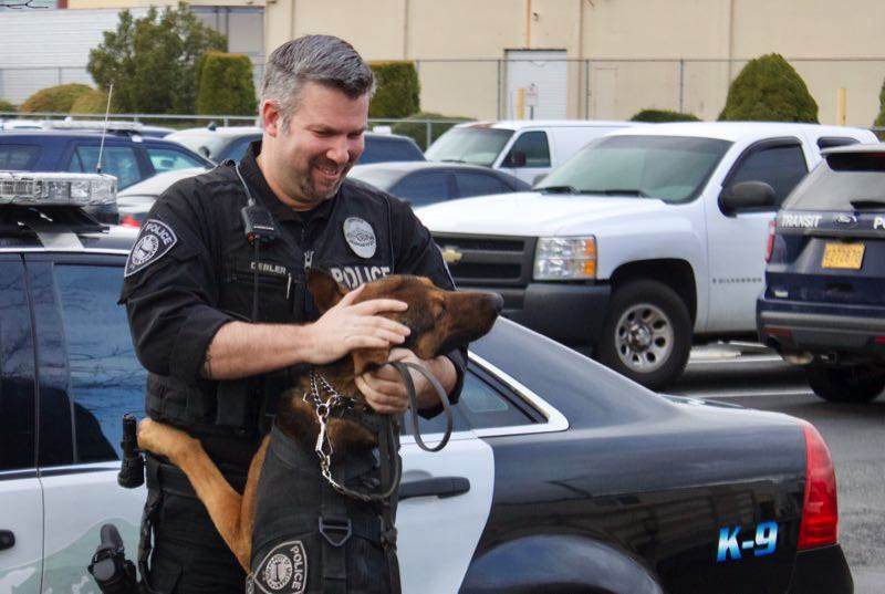 PMG FILE PHOTO - Officer Shawn Debler and his partner K9 Basco.