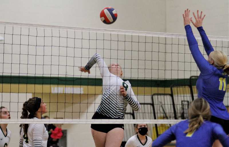 PMG PHOTO: WADE EVANSON - Gaston senior middle blocker Grace Smith goes up for a kill during the Greyhounds' win over Vernonia Tuesday, Sept. 28, at Gaston High School.