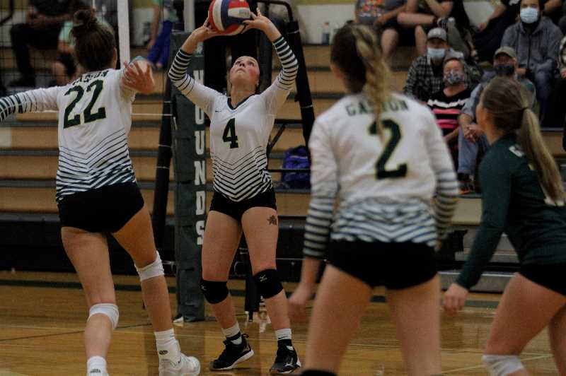 PMG PHOTO: WADE EVANSON - Gaston sophomore setter Lexi Fern (4) sets up a teammate during the Greyhounds' five set win over league rival Vernonia Tuesday, Sept. 28, at Gaston High School.