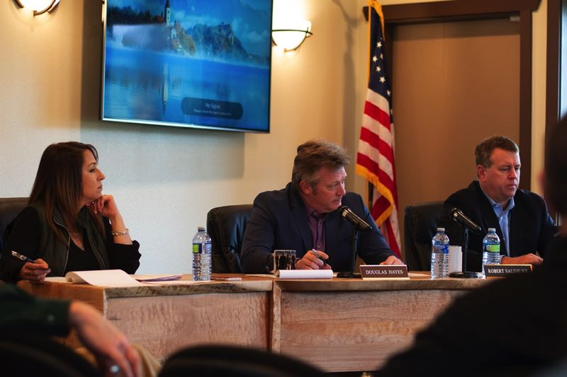 PMG PHOTO: ANNA DEL SAVIO - Port of Columbia County Executive Director Doug Hayes, center, appears at a 2019 board meeting.