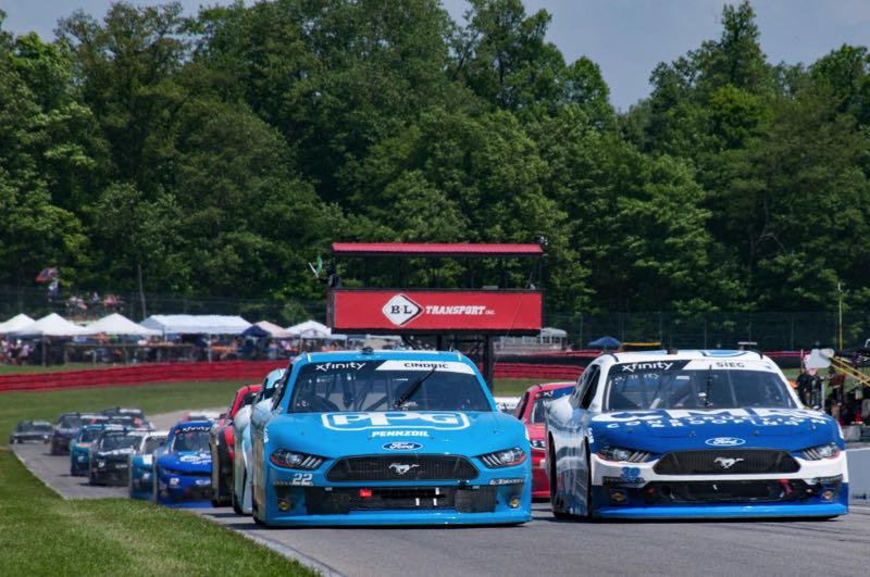 COURTESY GREEN SAVOREE RACING PROMOTIONS  - NACAR Xfinity racecars on a track in a race. They will be coming to Portland International Raceway on June 4, 2022.