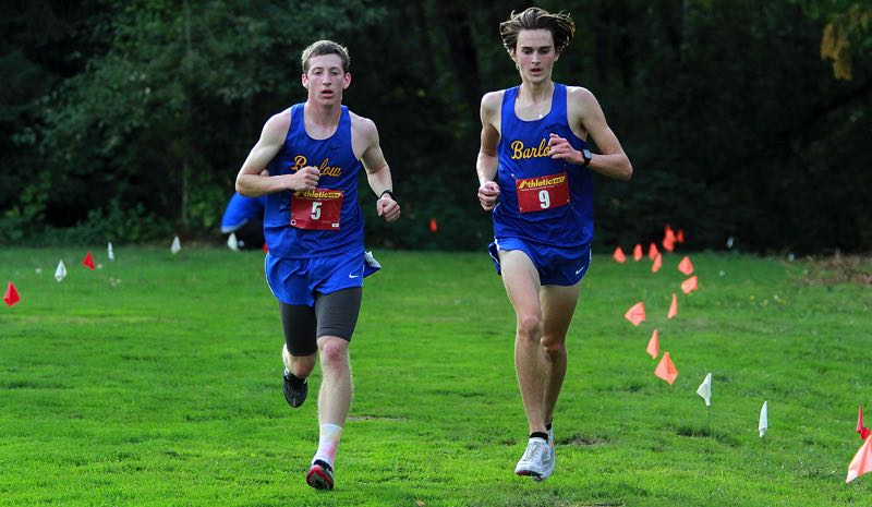 PMG PHOTO: MILES VANCE - Barlow senior Braydon Lee (left) and senior teammate Parker Waugh left the competition far behind to win the three-team Mt. Hood Conference meet at Barlow High School on Wednesday, Sept 29.