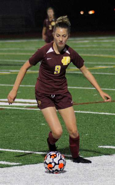 PMG PHOTO: WADE EVANSON - Forest Grove's Sophia Broberg scored four goals during the Vikings' match versus the Tigers Wednesday, Sept. 29, at Forest Grove High School.