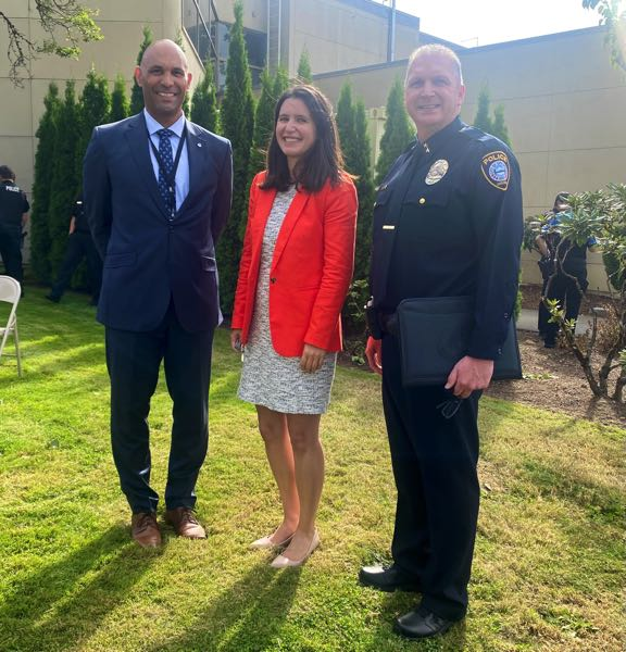 COURTESY PHOTO: CITY OF GRESHAM - Deputy City Manager Corey Falls, left, and City Manager Nina Vetter both welcomed Chief Travis Gullberg during his swearing-in ceremony.