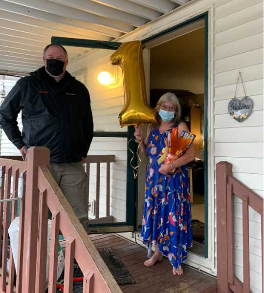 COURTESY PHOTO: COMCAST - Comcast technician Paul Hennan presented Cynthia Campbell, the companys first customer in Hubbard, with a gift basket and #1 balloon.