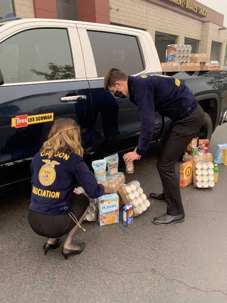COURTESY PHOTO: OREGON FFA - FFA members gather, sort and organize food during the annual October food drive the FFA stages in conjunction wtih Les Schwab Tire Centers.