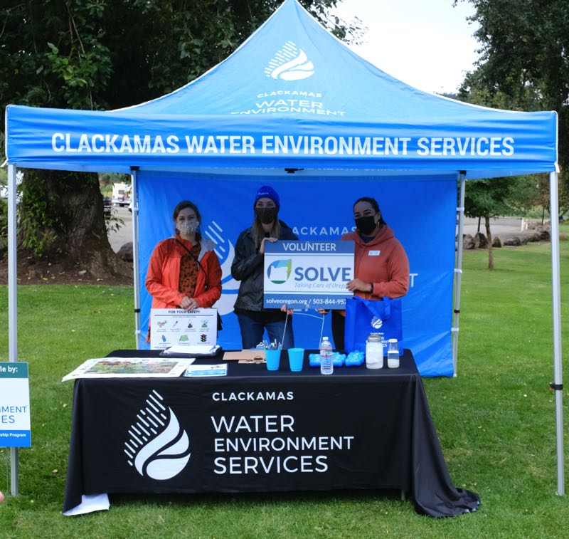 PMG PHOTO: JAELEN OGADHOH - SOLVE employees pose underneath the check-in booth at Clackamette Park in Oregon City.