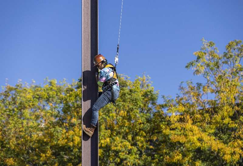 PMG PHOTO: JONATHAN HOUSE  -  KJ Selmo demonstrates how to climb a steel beam during Steel Day.