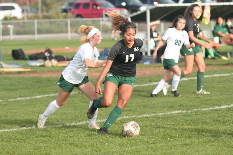 PMG PHOTO: TANNER RUSS - North Marion senior Dominique Huapeo recorded a hat trick against Estacada on Wednesday, Sept. 29.