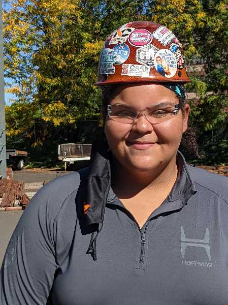 PMG PHOTO: JOSEPH GALLIVAN - Sierrah Kienit, a third generation apprentice Portland ironworker, was helping out at SteelDay. She loves her job for the cameraderie and problem solving. (Mask removed briefly for zoomed in photo.)