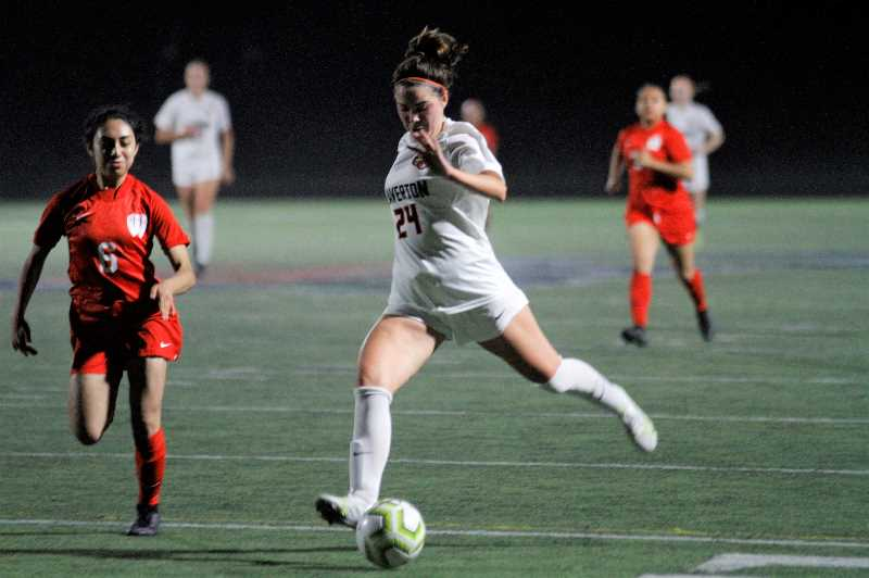 PMG PHOTO: WADE EVANSON - Beaverton senior Joey Baguio charges up the field during the Beavers' 3-0 win over Westview Thursday night, Sept. 30, at Westview High School.