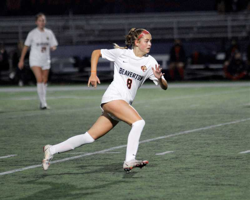PMG PHOTO: WADE EVANSON - Beaverton senior Meg Unruh races down the pitch during the Beavers' game with Westview Thursday night, Sept. 30, at Westview High School.