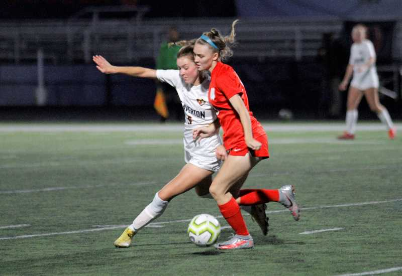 PMG PHOTO: WADE EVANSON - Westview senior Sydney Kleine battles with Beaverton's Emily Rice for a loose ball during the two teams' match Thursday night, Sept. 30, at Westview High School.