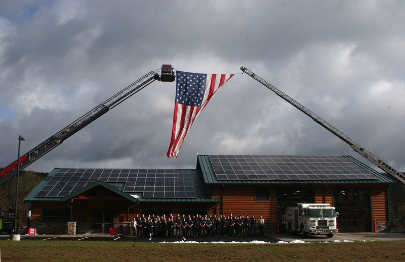 COURTESY PHOTO - Banks Fire District personnel gather outside the new Hornshuh Creek Fire Station #14, located near Buxton along Highway 26.
