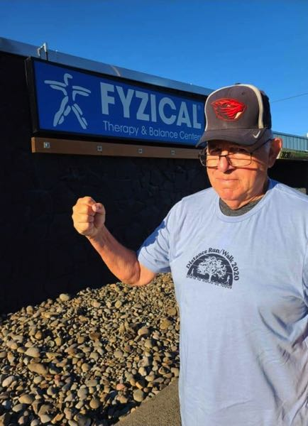COURTESY PHOTO - Ralph Brown poses for a photo running in front of the Fyzical Therapy & Balance Center in Forest Grove. An avid runner, Brown volunteered and coached for decades in the area.
