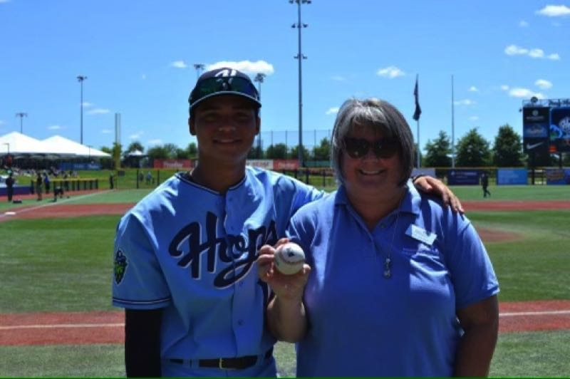 COURTESY PHOTO - Aron Carleson, right, poses for a photo with Hillsboro Hops baseball player Kai-Wei Lin.