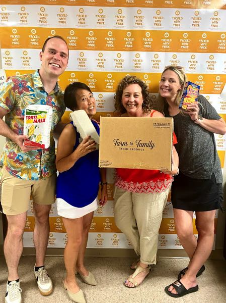 COURTESY PHOTO - Volunteers with Packed with Pride, including (from left) Ben Bowman, Margie Yemoto-Green, Nicole White and Tristan Irvin display some of the wares donated to the organization.