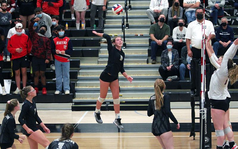 PMG PHOTO: MILES VANCE - Nelson junior Kali Lukovich hangs in the air for an attack during her team's 25-21, 25-10, 25-13 win over Sandy at Nelson High School on Thursday, Sept. 30.
