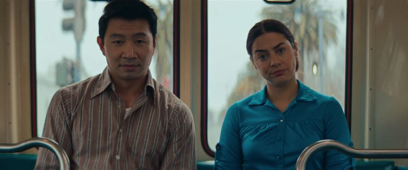 COURTESY PHOTO: LOOK AT THE MOON PICTURES - Simu Liu (left), who is currently starring in Marvel show Shang-Chi and the Legend of the Ten Rings, plays a bank supervisor trying to help out Celina (Lorenza Izzo, left) in Women Is Losers.