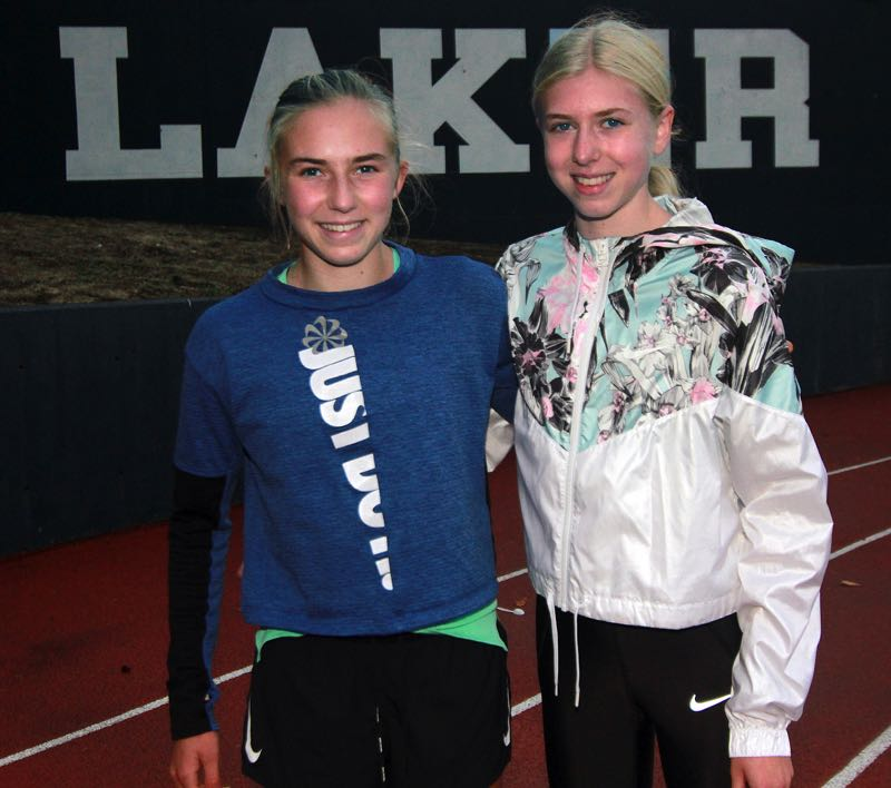 PMG PHOTO: MILES VANCE - Lake Oswego's Kate (left) and Ana Peters currently have the two best times in Three Rivers League cross country and hope to lift the Lakers to a state meet berth.