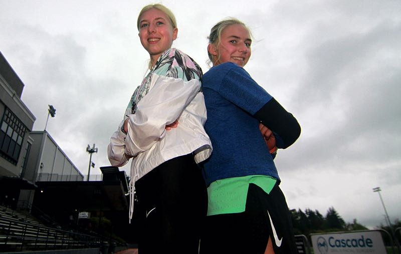 PMG PHOTO: MILES VANCE - Lake Oswego's Kate (right) and Ana Peters currently have the two best times in Three Rivers League cross country and hope to lift the Lakers to a state meet berth.