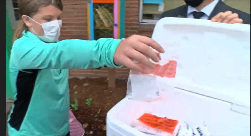 SCREENSHOT - A student at Whitman Elementary School in Portland drops off a saliva sample for COVID-19 testing. Portland Public Schools announced on Oct. 1 that it will now start offering weekly COVID-19 screening for students as an early detection system.