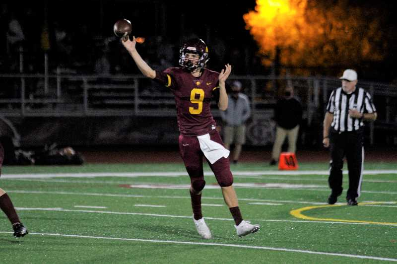 PMG PHOTO: WADE EVANSON - Forest Grove quarterback Kaden Hale throws from outside the pocket during the Vikings' game against St. Helens Friday night, Oct. 1, at Forest Grove High School.