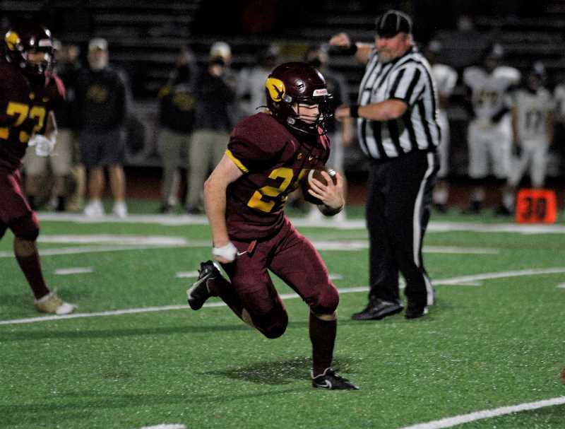 PMG PHOTO: WADE EVANSON - Forest Grove junior running back Sam Blanton carries the ball during the Vikings' game against St. Helens Friday night, Oct. 1, at Forest Grove High School.