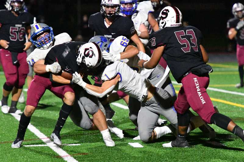 COURTESY: DEAN TAKAHASHI - The Newberg defense showed flashes of its strength against Sherwood, but surrendered a late touchdown in the loss.