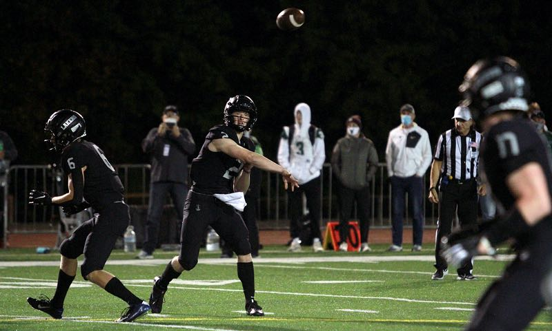PMG PHOTO: MILES VANCE - Lake Oswego senior quarterback Jack Layne releases a pass during his team's 35-0 win over Tigard at Lake Oswego High School on Friday, Oct. 1.