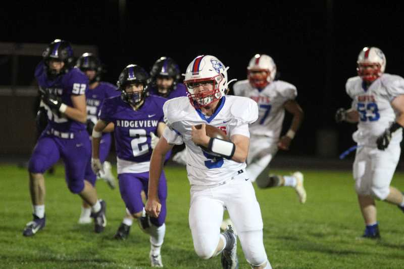 PMG PHOTO: ANDY DIECKHOFF - Madras quarterback Dru Boyle, with ball, rushed for over 100 yards and two touchdowns against Ridgeview on Friday night. After the game, head coach Kurt Taylor said, 'I think we just found our Brett Favre.'