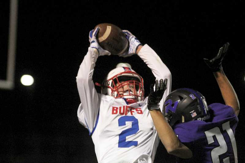 PMG PHOTO: ANDY DIECKHOFF - Madras junior Cael White (2) had four catches for 80 yards against Ridgeview, and he also added two interceptions on defense. White leads the team in receptions, receiving yards and interceptions so far.