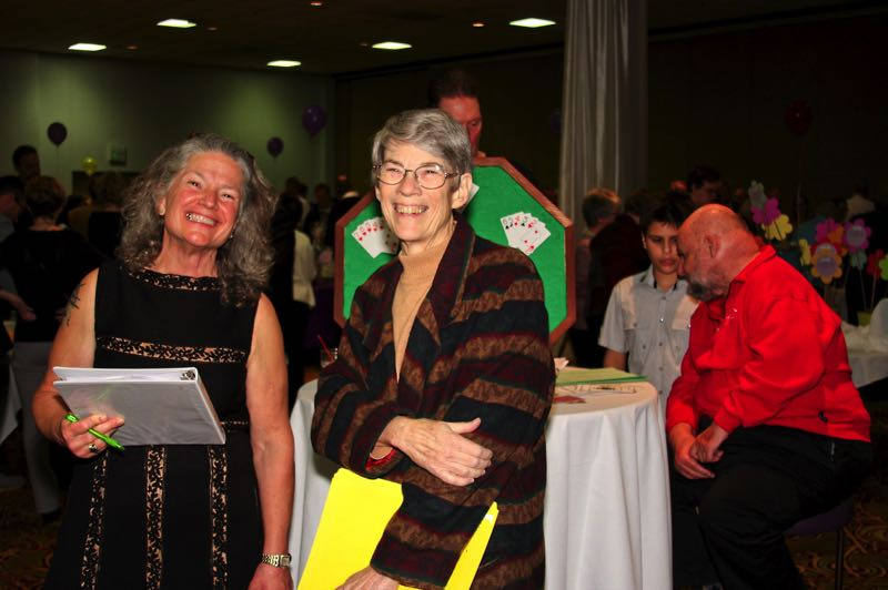PMG FILE PHOTO - Former state Rep. Carla Piluso, left, was involved in local events and organizations during her public tenure. Here, she was master of ceremonies for SnowCap Community Charities' dinner and auction.
