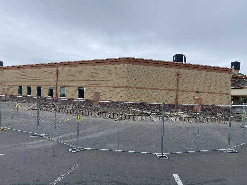 PMG PHOTO: HOLLY BARTHOLOMEW - On the backside of the new post office, crews are working to build new truck loading ramps.