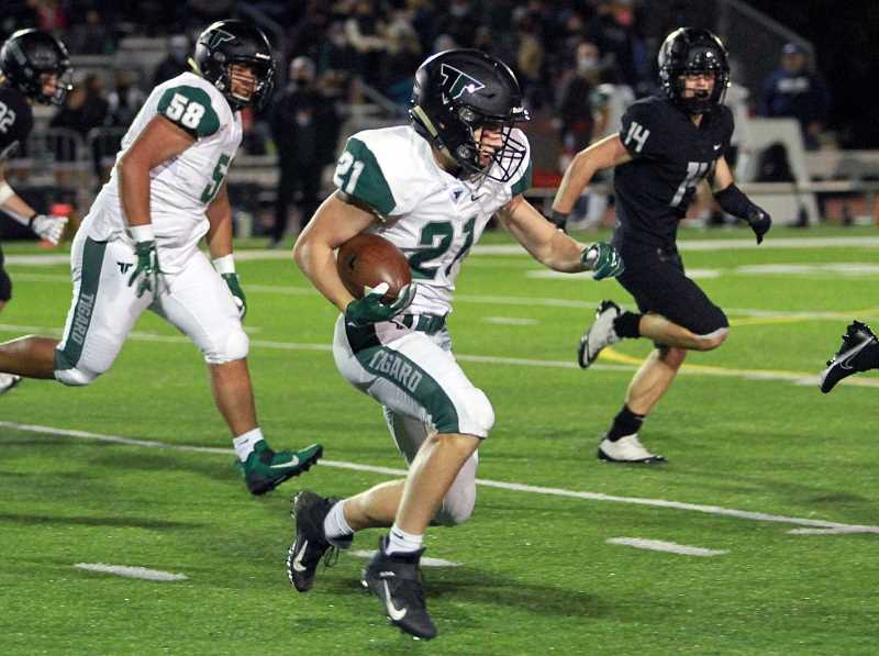 PMG PHOTO: MILES VANCE - Tigard senior running back Braden Graf carries the ball during the Tigers' game against Lakeridge Friday night, Oct. 1, at Lakeridge High School.
