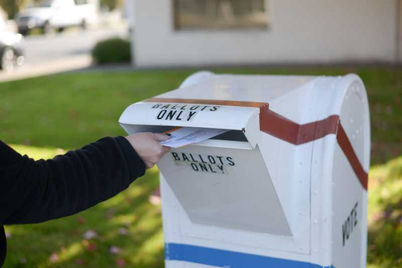 PMG FILE PHOTO - A ballot is deposited in a drop box in Columbia County.