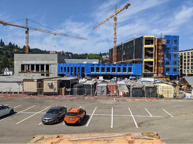 PMG PHOTO: JOSEPH GALLIVAN  - The number of construction cranes in Portland decreased in the first six months of 2021. This crane at Northwest 20th Avenue and Pettygrove Street in Slabtown was in full swing in October 2021.