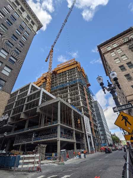 PMG PHOTO: JOSEPH GALLIVAN  - The number of construction cranes in Portland decreased in the first six months of 2021. This crane at Block 216 at 10th Ave. and Washington Street is at the site of a future Ritz-Carlton Hotel.